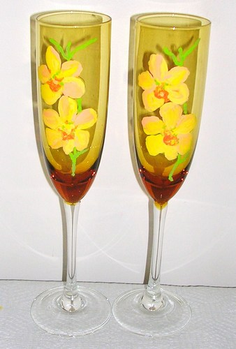 2 Yellow Orchid champagne flutes on colored glass $90