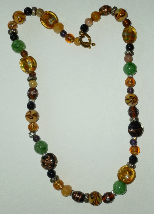"Honey & rust glass beads with green jade, 28"", $125"