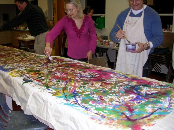 Vancouver Dunbar Acrylics group working together on a Jackson Pollock