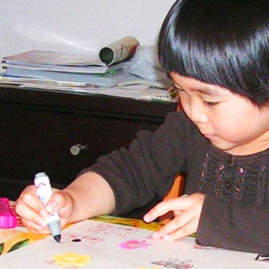 Child painting at Vancouver art workshop